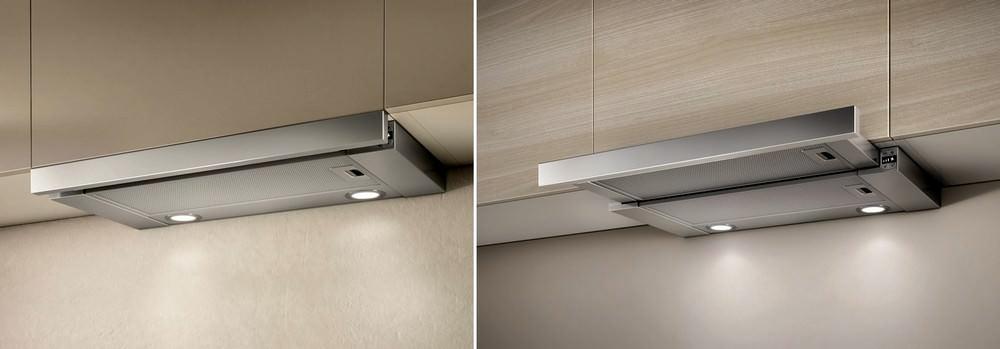 Выдвижная панель, которой снабжена часть вытяжных приборов при необходимости задвигается и в этом случае наличие вытяжки на кухне практически не заметно