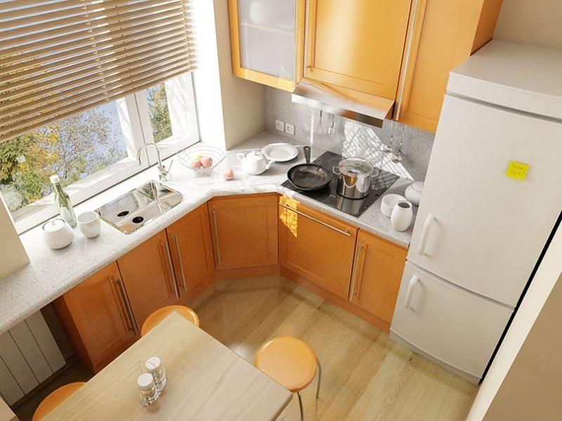 Угловое расположение рабочей зоны, охватывающей подоконник – один из наиболее оптимальных вариантов для небольшой кухни в 6 кв. м