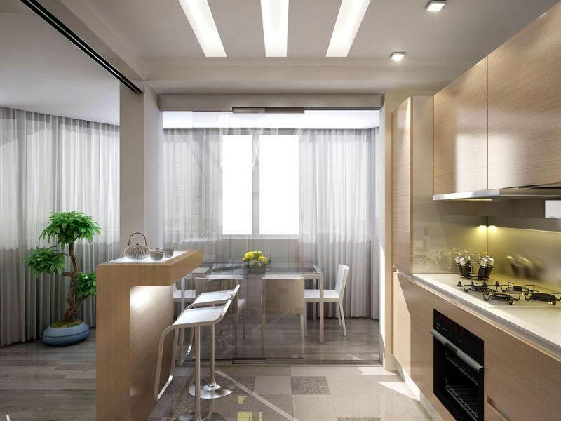 Барная стойка, напольные покрытия и колонны способствуют в зонировании кухни-столовой, совмещенной с гостиной