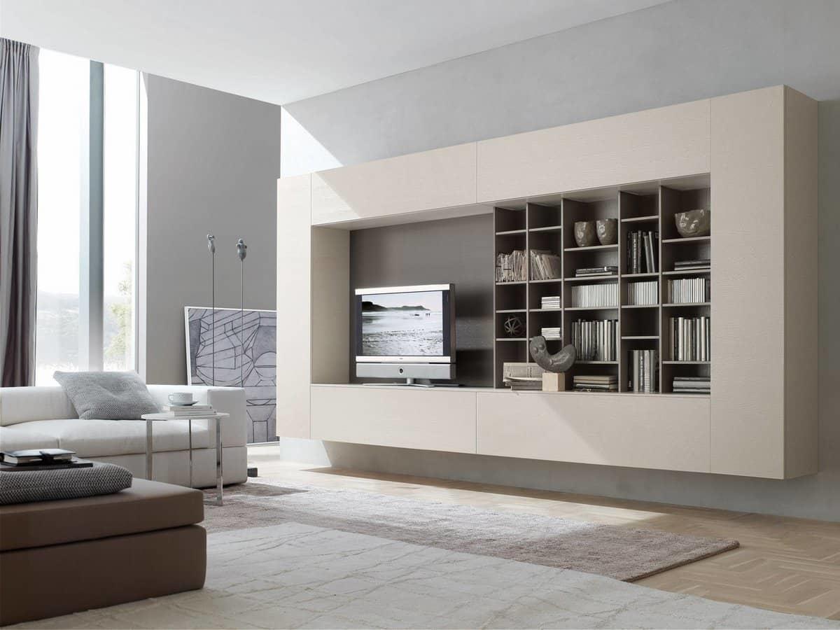 Стильный и функциональный подвесной шкаф — отличное решение, которое визуально увеличит пространство гостиной