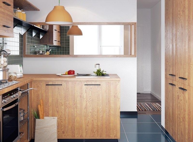 Строгие фасады в светлых тонах и встроенная техника визуально сделают компактную кухню более просторной