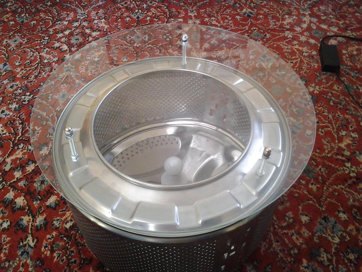 Из барабана старой стиральной машины можно сделать оригинальный столик