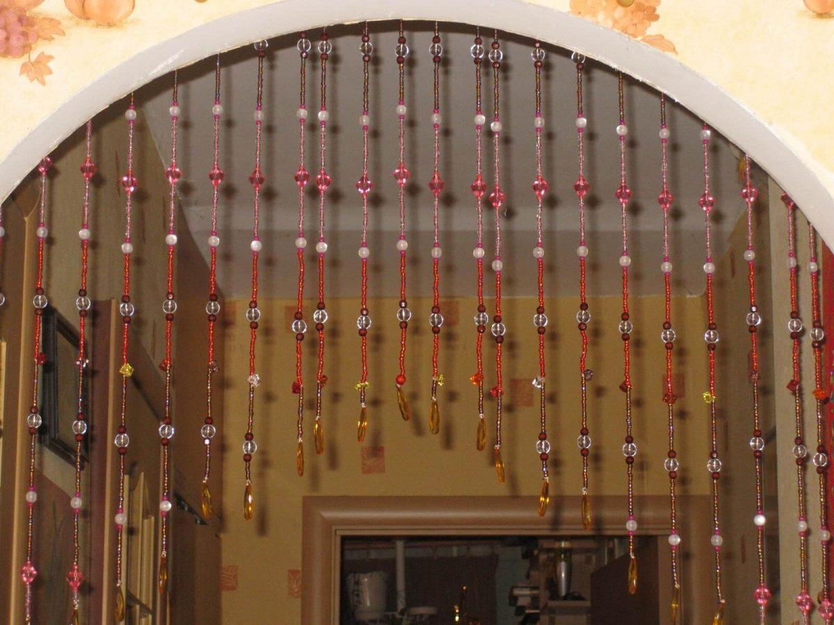 Шторы в технике макраме хорошо вписываются в дверную арку