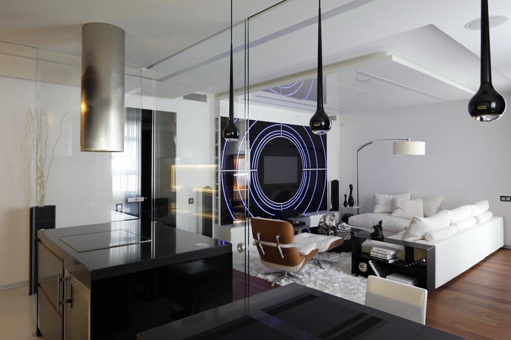 Прекрасным вариантом для смежной кухни-гостиной средних размеров станет стиль хай-тек