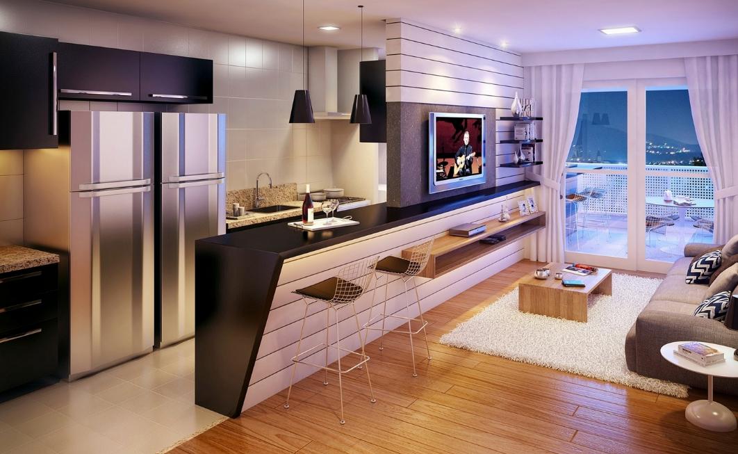 Разделить зоны кухни и гостиной можно с помощью барной стойки или столешницы