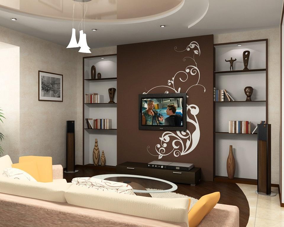 Стильно и красиво дополнить интерьер комнаты можно при помощи небольшой картины с пейзажами и статуэтками
