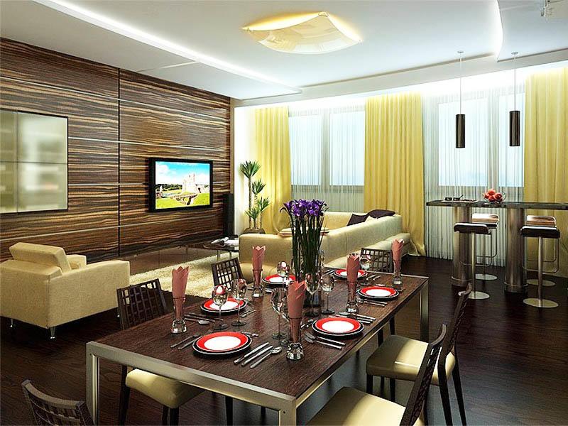 Для кухни-гостиной в частном доме, обладающей большой площадью, немалое значение стоит уделить освещению. Рекомендуем попробовать использовать подвесной потолок с подсветкой. Такое решение позволит сделать свет мягким и равномерным, кроме того, дизайн станет значительно оригинальнее