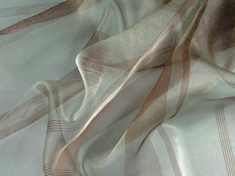 В хлопковые ткани для блеска и долговечности могут добавляться синтетические волокна