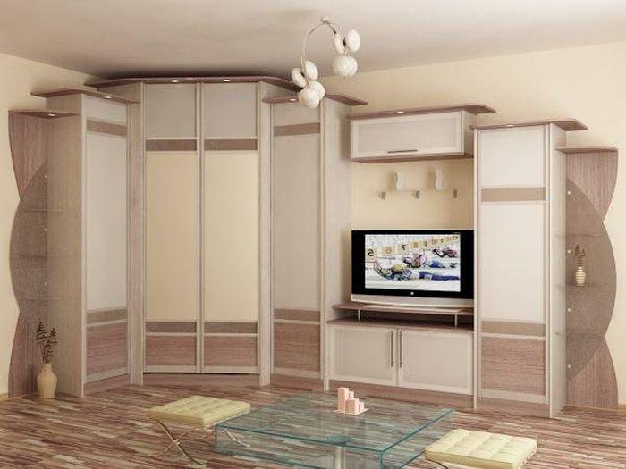 В интерьер гостиной прекрасно впишется современный угловой шкаф
