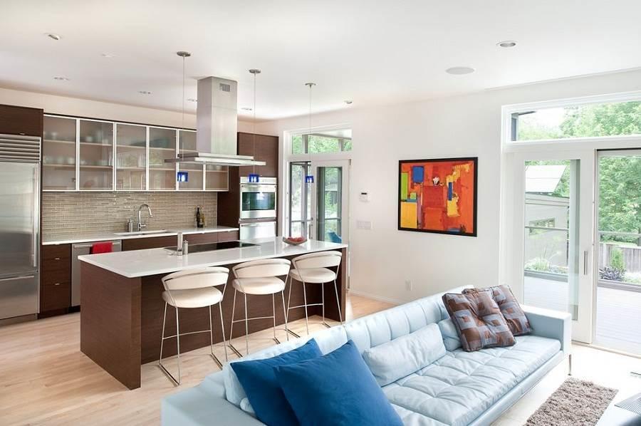 П-образная кухня, совмещенная с гостиной, должна гармонировать с общим дизайном