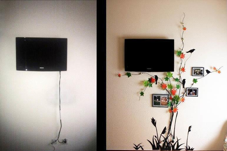 Спрятать провода от телевизора на стене не сложно, главное, - проявить фантазию. К примеру, можно использовать декоративное дерево - дизайн кухни от этого только выиграет, ведь подобное решение можно встретить нечасто