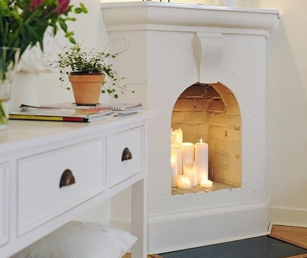 Угловой камин хорошо впишется в небольшую комнату благодаря своим компактным размерам