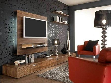 Оформлять стену под телевизор следует таким образом, чтобы она гармонично вписывалась в общий стиль помещения