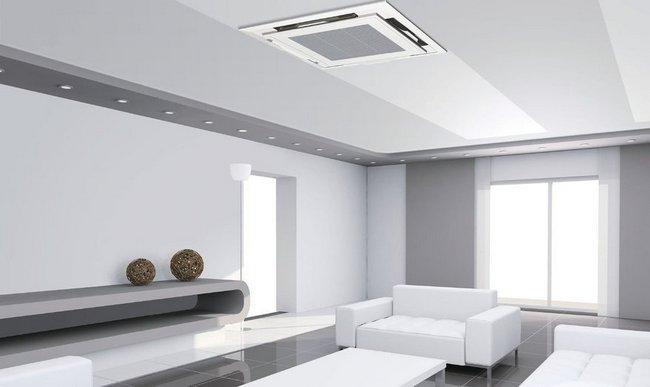 Кассетная сплит-система. Кондиционеры имеют мощность 5-14 кВт и размещаются также над навесным потолком