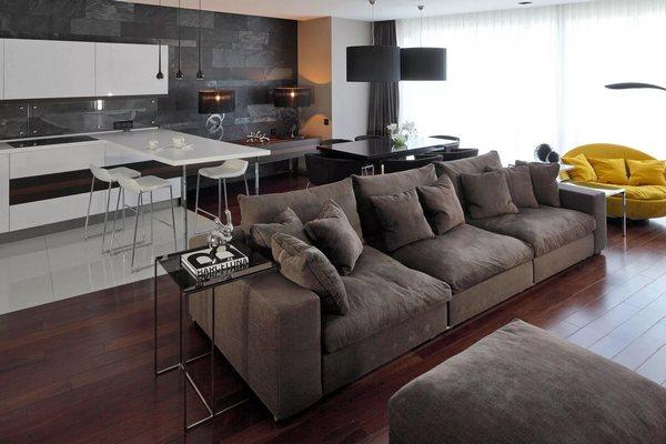 Как грамотно вписать диван в дизайн кухни